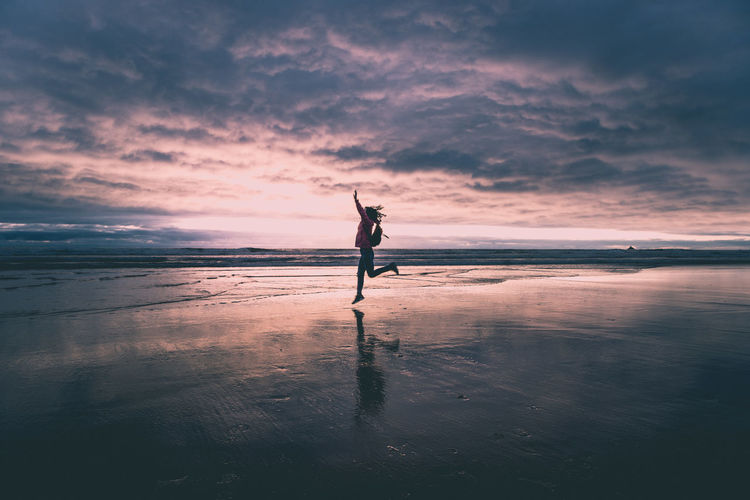 Dancing on the Beach Beach Beauty In Nature Cloud - Sky Enjoying Life Horizon Over Water Jumping Landscape Nature Ocean One Person Oregon Coast Outdoors Reflection Scenics Sea Silhouette Sky Sunset Tranquil Scene Tranquility Water Young Women Lost In The Landscape