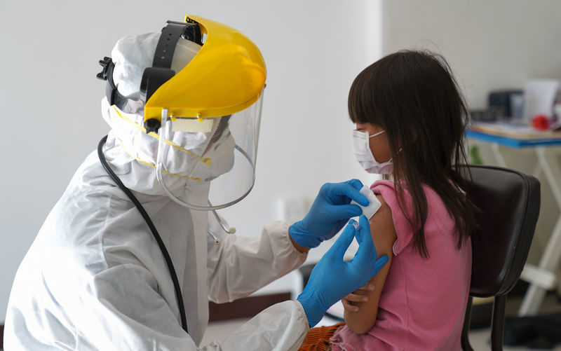 Covid-19 vaccination injection on arm, coronavirus syringe and needle. doctor or nurse