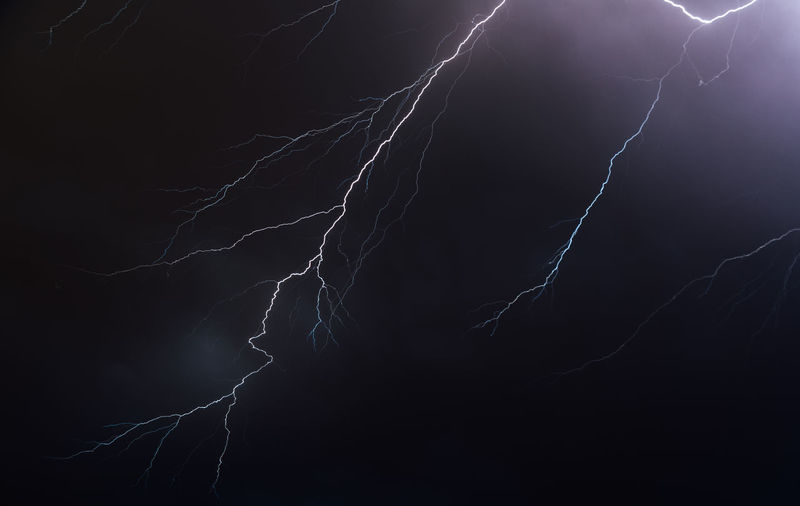 Night sky illuminated by lightning bolts Abstract Beauty In Nature Black Background Cloud - Sky Dark Electricity  Illuminated Light Lightning Low Angle View Nature Night Pattern Power Power In Nature Purple Sign Storm Thunderstorm Warning Sign HUAWEI Photo Award: After Dark