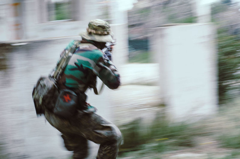 Blurred motion soldier Outdoors Sport Soldier Airsoft Blurred Motion Motion Speed Running Real People Day People Weapon Uniform Backpack Backview Hat Camouflage Special Forces