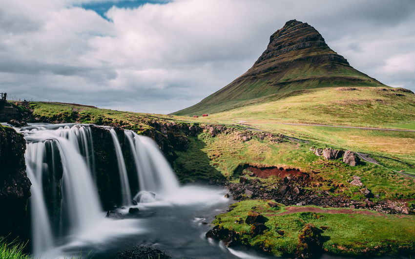 kirkjufellfoss at krikjufell mountain in south iceland Iceland Kirkjufell Snaefellsnes Peninsula Beauty In Nature Cloud - Sky Environment Flowing Water Iceland Trip Iceland_collection Land Landscape Long Exposure Motion Mountain Mountain Range Nature No People Non-urban Scene Outdoors Scenics - Nature Sky Tranquil Scene Water Waterfall Waterfall_collection The Traveler - 2018 EyeEm Awards The Great Outdoors - 2018 EyeEm Awards