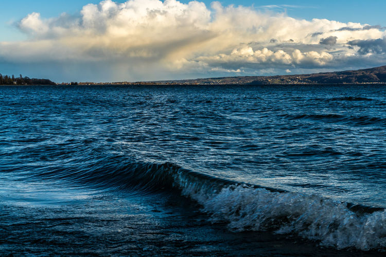 Squally on lake constance with powerful clouds