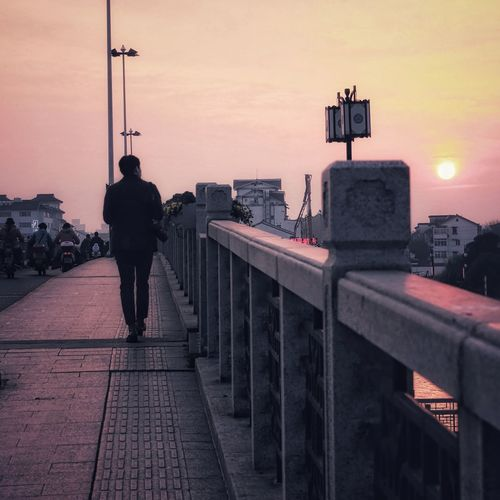 The man in the city, and the sunset.... City Cityscape Politics And Government Full Length Sunset Urban Skyline Silhouette Men Sky Bridge - Man Made Structure Railway Bridge Footbridge Back