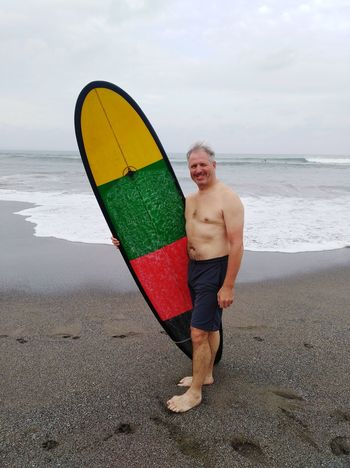 Silver Surfer! Healthy Lifestyle Middle Aged Man EyeEm Selects Sportsman Sea Full Length Water Beach Men Standing Portrait Shirtless Sport Surfboard Surfer Surf Wave Tide Water Sport Surfing