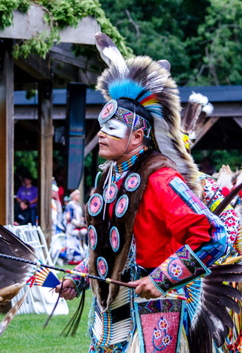 september 3, 2017, American Indian man in traditional clothing, or reglaia, participates in a traditional dance competition at the Kee-Boon-Mein-Kaa Pow Wow in Dowagiac Michigan USA Pow Wow Dancer Pow Wow Native American Indian Beautiful Dowagiac Feathers Horizontal Michigan USA American Indian Clothing Colorful Competition Editorial  Head Piece Leisure Activity Lifestyles Native Amereican Real People Regalia Clothes Traditional Dancing Traditional Festival