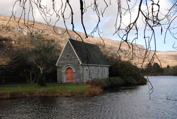 St. Finbarr's Oratory, Ballingeary, County Cork, Ireland Ballingeary County Cork Gougane Barra Macroom St. Finbarr's Oratory Architecture Bare Tree Branch Building Building Exterior Built Structure Day Lake Nature No People Outdoors Religion Sky Tree Water Waterfront
