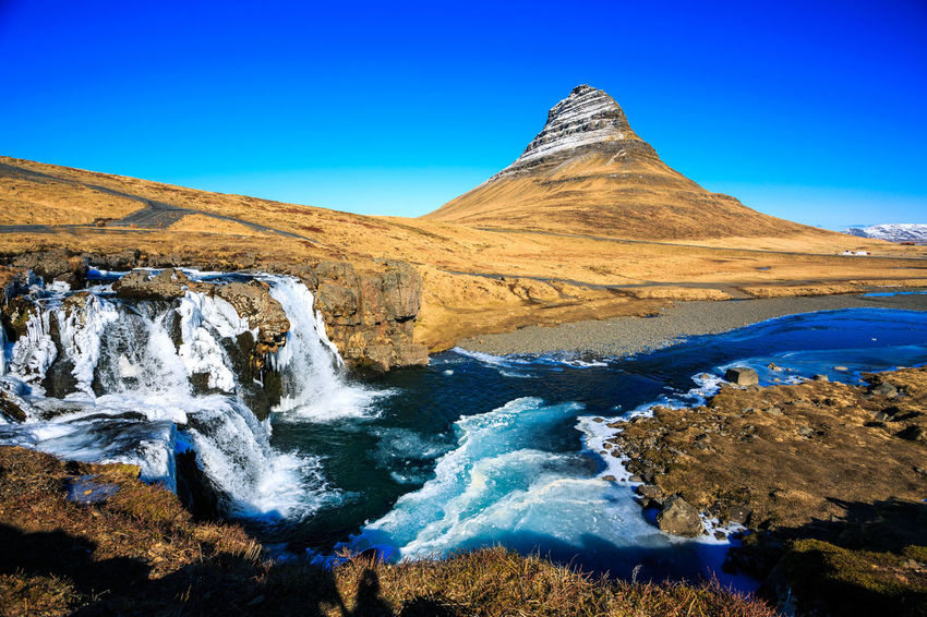 Beauty In Nature Blue Clear Sky Day Iceland Kirkjufell Kirkjufellsfoss Landscape Mountain Mountains Nature No People Outdoors River Scenics Sky Tranquil Scene Tranquility Water Waterfall