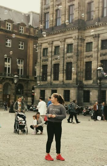 Amsterdam City Life Bubbles Streetphotography City People Watching Architecture Building Exterior Full Length Built Structure Men Transportation Street City Casual Clothing Person Holding Day Casual City Life Outdoors Bubbles... Bubbles...Bubbles....