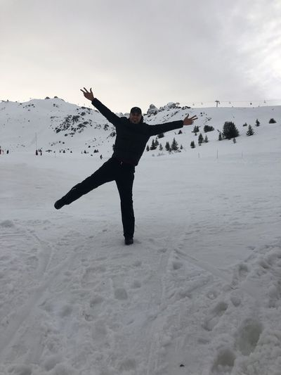 Full length of person on snow covered land