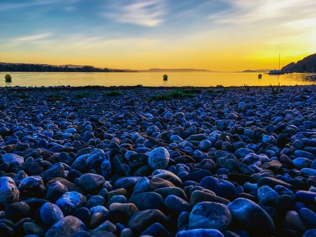 Past Masters Beauty Beauty In Nature Peaceful Zen Meditate Switzerland Shore Nature Lover Nature Photography Clouds And Sky Sailboat Mystical Atmosphere Mystic Stones Stones & Water Lakeshore Lake Sunset Sky Water Sea Nature Beauty In Nature Tranquility Tranquil Scene