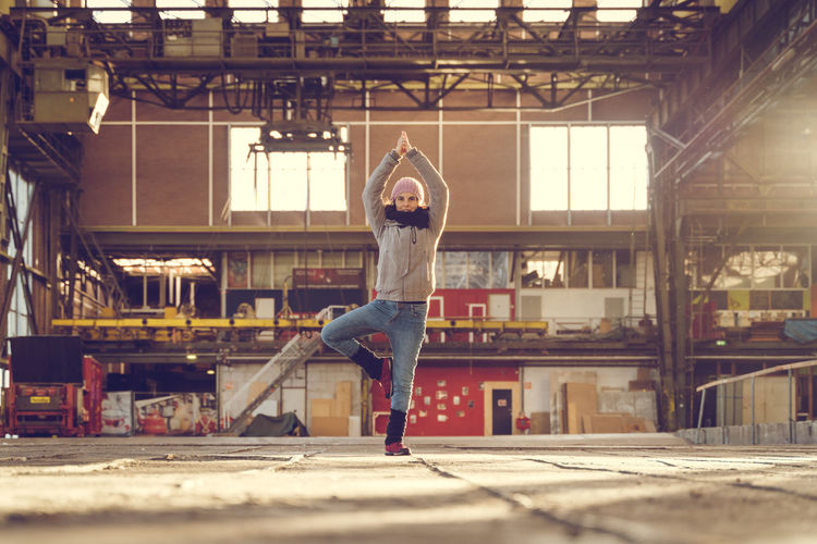 Yoga everywhere One Person Architecture Real People Lifestyles Leisure Activity Vitality Young Adult Casual Clothing Motion Day Excitement Yoga Yoga Pose Yogagirl Yoga Practice Everywhere Yoga Everywhere Every Day Yogi Factory Factory Building