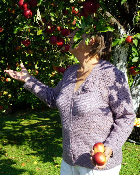 woman kills apples Plant Fruit One Person Food And Drink Healthy Eating Food Apple - Fruit Day Standing Nature Growth Tree Grass Fruit Tree Holding Wellbeing Field Real People Leisure Activity Outdoors Ripe Human Arm Handmade Sweater Purple Beautiful Day
