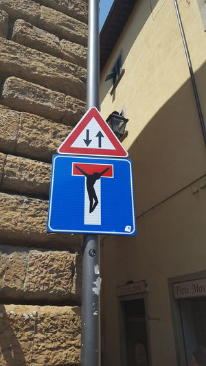 Clet Abraham Street Art Road Sign Communication No People Outdoors Close-up Architecture Diversion The Week On EyeEm Your Ticket To Europe Mix Yourself A Good Time Rethink Things Visual Creativity Adventures In The City