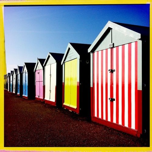 fantastically colourful beach huts at Hove sea front.