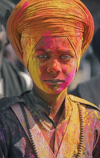 Portrait of man wearing multi colored mask