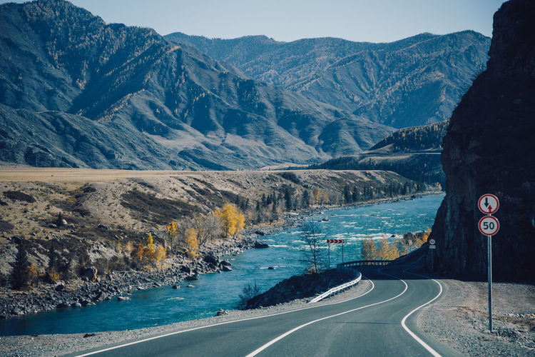 Scenic view of road by mountains