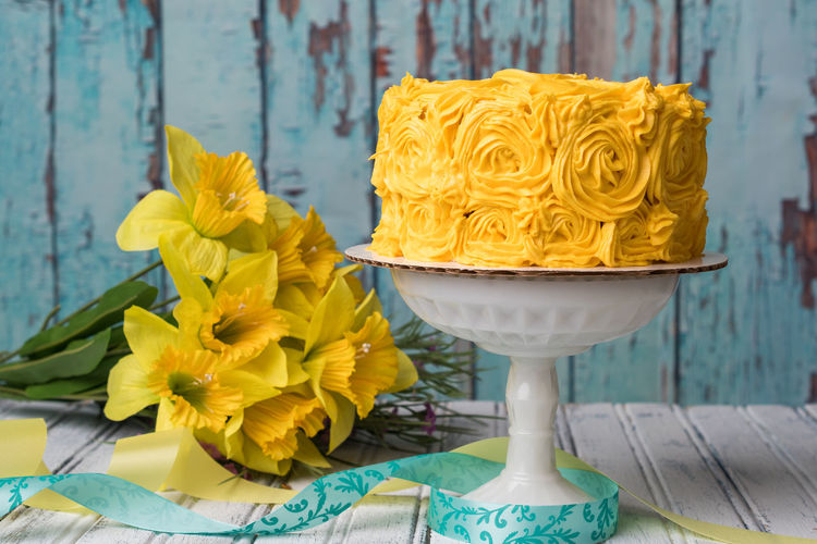 Yellow cake with daffodils in rustic setting Easter Rustic Cake Daffodil Flower Indoors  Outside Spring Sweet Food Yellow Yellow Cake