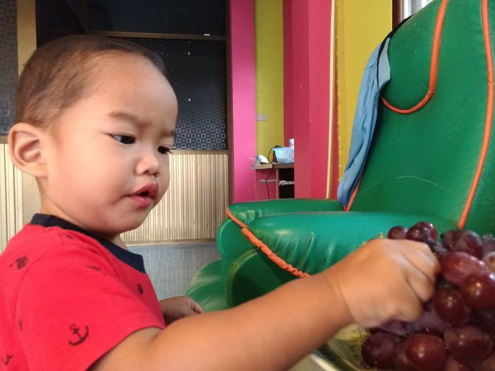 Eating grapes Hand Face Headshot Standing Mouth See Fruits Keep Fruits EyeEm Selects Human Hand Childhood Close-up Colorful Sewing