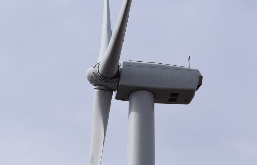 Wind Power in Northwestern Indiana Clear Sky Day Industry Low Angle View No People Outdoors Pole Sky Technology