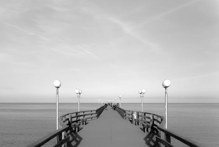 Pier Leading To Calm Sea