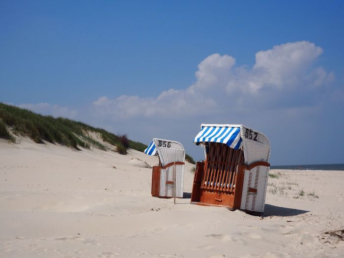 Spiekeroog Strandkorb Beach Sand Hooded Beach Chair Shore Sky Sea Nature Beauty In Nature Summer Cloud - Sky Outdoors Day Vacations Tranquility Sunlight Water