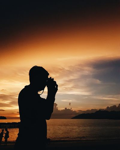 Sunset Silhouette Sunset Water Tranquil Scene One Person Sky People Outdoors Close-up Nature EyeEm Selects Sea Beach Beauty In Nature Sunlight And Shadow Sunset_collection Cloud - Sky Mood Travel Destinations Travel Silhouette Langkawi Island Moodoftheday Langkawi Sky