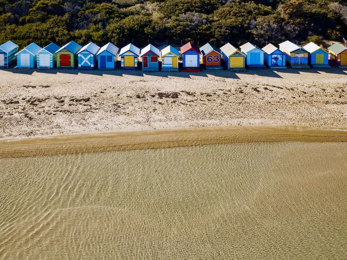 An aerial view of the colourful boat houses at the brighton beach in melbourne