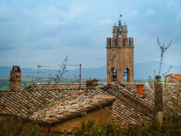 High angle view of bell tower and roof tiles in montepulciano, tuscany