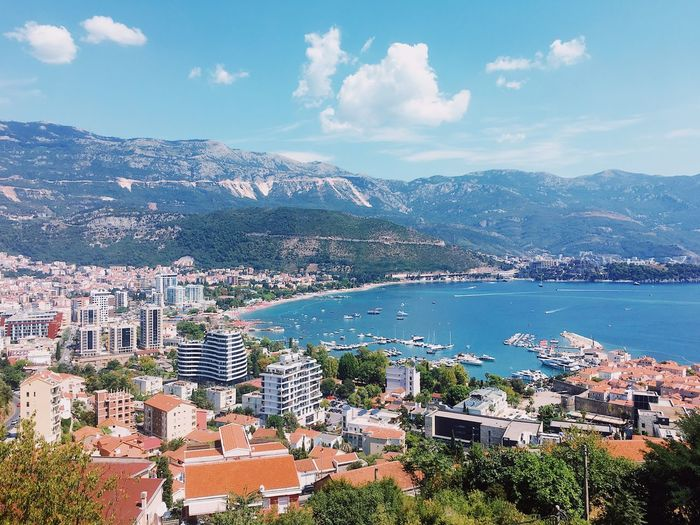 Summer in Montenegro Budva,Montenegro Montenegro Budva Mountain View Sea View View Summer Water Mountain Building Exterior Sky Architecture City Sea Nature High Angle View Cloud - Sky Beauty In Nature Building Day Cityscape Mountain Range