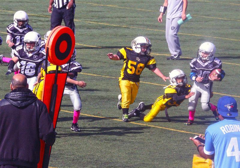 Junior Football at Minoru Park Richmond B.C Canada. Headwear Outdoors Team Sport Activity Richmond BC, Canada Junior Football Running Sports Clothing Football Helmet Minoru Park Uniform Sports Team