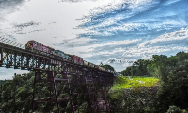Crossing the trestle. Train Trestle Tracks Train Tracks Bridge Letchworth State Park Letchworth - The Grand Canyon Of The East HDR Hdr_Collection Hdr Edit Overedited (yeah I know) New York Architecture Clouds Clouds And Sky Sky Diesel Engine Diesel Locomotive Into The Light Enjoying The Sun Malephotographerofthemonth Point And Shoot Low Angle View