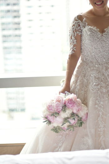 Flower Wedding Dress Only Women Adults Only Indoors  Window Adult One Woman Only Bride One Person Bouquet People Wedding Young Adult One Young Woman Only Day Life Events The Portraitist - 2017 EyeEm Awards Nikon D500 Beautiful Woman Nikon Bride Portrait Young Women Close-up The Portraitist - 2017 EyeEm Awards