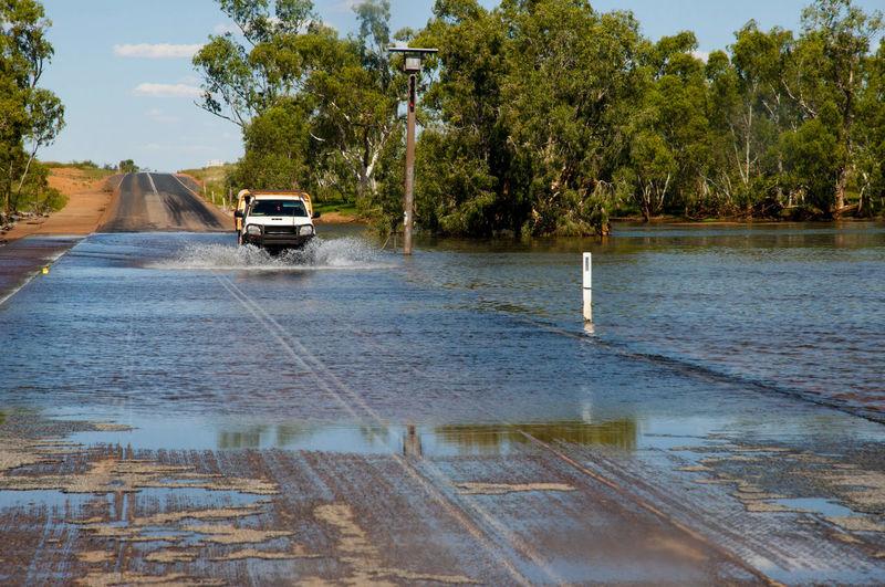 Cars on wet river during rainy season