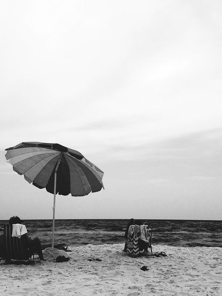 Panama City Beach Beach Sea Summer Water Horizon Over Water Outdoors Nature Day People Sky Adult Only Men Animal Themes Umbrella Saltwater Saltlife Blackandwhite Nature United States Personal Perspective Sadness Scenics Close-up Clouds And Sky Real People