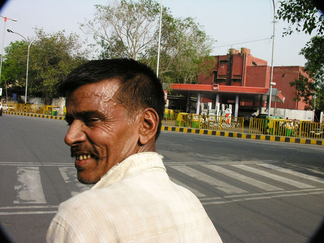 Happy rickshaw driver in Delhi, India. Characters Delhi Drivers Heat India Moustaches Rickshaws Smiles Streets Sweat Tourism Transport Travel Workers