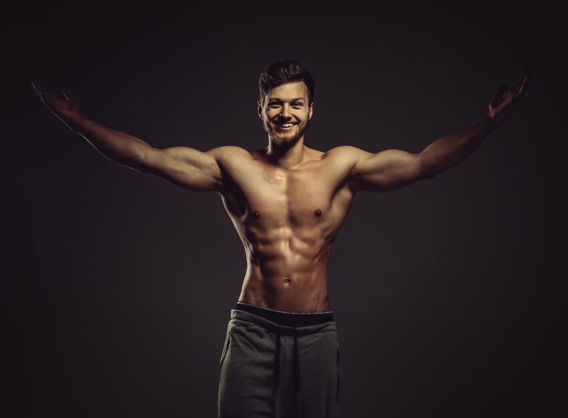 Athletic handsome young man posing in a studio Athlete Athletic Looking At Camera Man Masculinity Sportsman Abdomen Abs Attractive Beauty Caucasian Fitness Fitness Model Male Men Muscle Muscular Build One Person Physique  Smiling Sport Sportive Strong Studio Shot Young Adult
