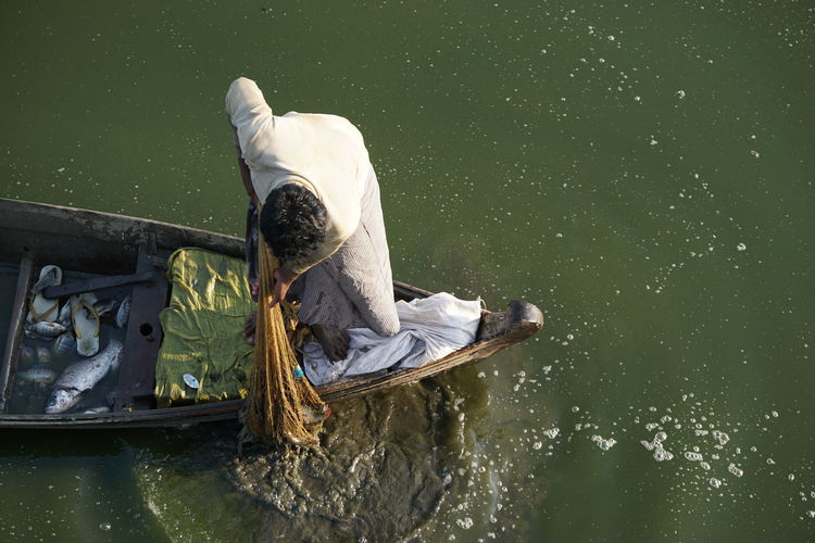 High angle view of man fishing in lake