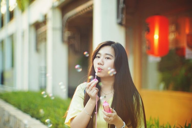 Long Hair One Person People Only Women Adult Front View One Woman Only Holding Headshot Beautiful Woman Adults Only Outdoors Beauty Young Adult One Young Woman Only Protruding Day Portrait City Bubble Wand