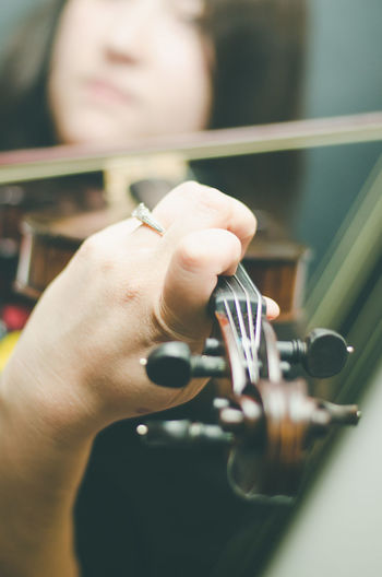 Close-up Holding Human Body Part Human Hand Indoors  Lifestyles Music Musical Instrument Musician One Person People Real People Violin Violinist Women