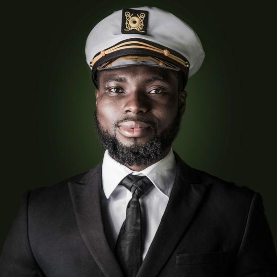 Portrait of police man against black background
