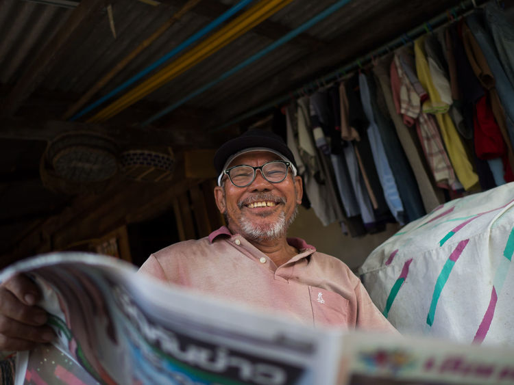 My dad is reading a newspaper while taking a break. Dad Newspapers Beard Daddy Day Eyeglasses  Father Gray Hair Happiness Indoors  Mature Adult Mature Men Newspaper One Person People Real People Senior Adult Senior Men Smile Smiling