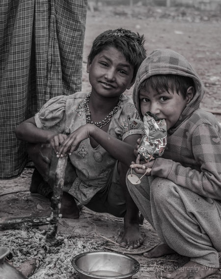 I don't use someone's poverty for my own amusement, it made me feel more pleased, more happy by spending my time with them. They are not jealous of us, not having an ego, bad attitude. They don't need expensive gift, just give them anything with love and smile. All you get back is their blessing, smile and happiness. EyeEmNewHere Two People Sitting Togetherness Street Photography Indianstories India_clicks Black & White EyeEm Best Shots - Black + White Black And White Portrait Bnw Portrait Domestic Life Friendship Street Life EyeEmNewHere