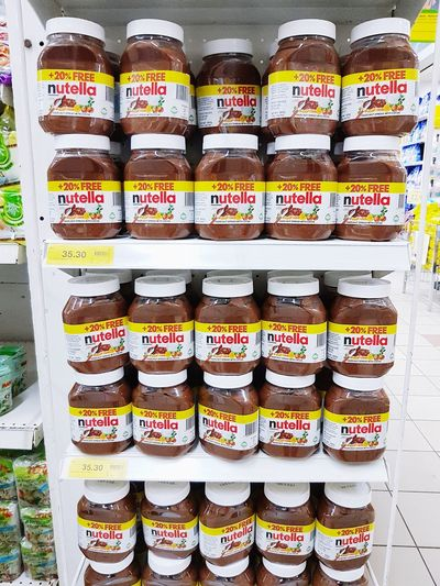 Nutella brand product on retail shoo shelf display. Brand Freshness Nutellalove Sweet Taste Flavor Chocolate Cooking Ingredient Nutrition Nutella Sweet Food No People Indoors  Day Price Tag Retail  Retail  Unhealthy Eating Market Business Store Food Variation Choice