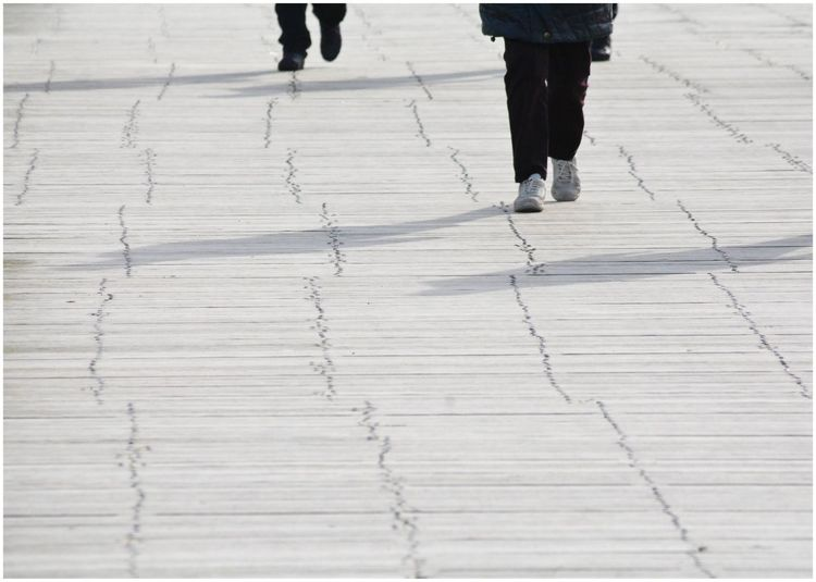 Low Section Of People Walking On Footpath