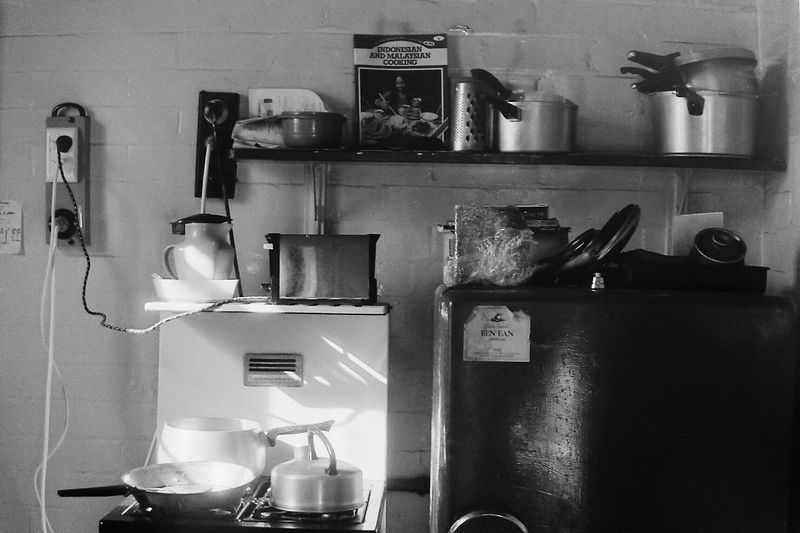 Domestic Kitchen Kitchen Indoors  Domestic Room Shelf No People Home Interior Large Group Of Objects Variation Appliance Stainless Steel  Cooking Utensil Refrigerator 1980 Cabinet Toaster Food Day Monochrome Light And Shadow Black And White Grunge Still Life