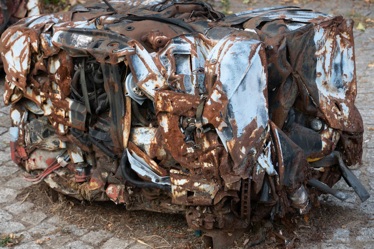Abandoned rusty pressed piece of car No People Abandoned Garbage Metal Environmental Issues Steel Frame Rusty Pressed  Junkyard Broken Trash Pollution Motor Vehicle Waste Management Environment Obsolete Discarded Wreck Outdoors Day