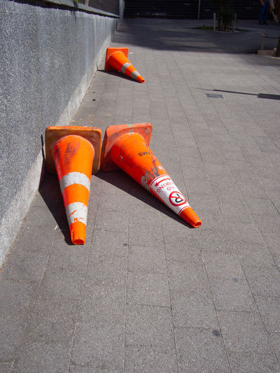 Traffic cones on a footpath City Cone Footpath Orange Color Road Cones Safety Sidewalk Traffic Cone