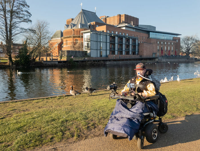 Outdoors Building Exterior Adult Water Day Architecture Built Structure Sitting Full Length Men People Real People Wheelchair Duchenneheroes Architecture Ventilator Royal Shakespeare Theatre