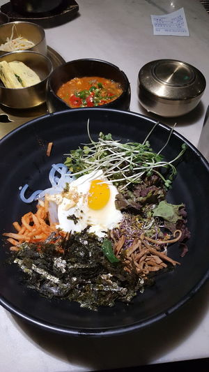 Korea Traditional Food Bibimbab Delicious Egg Yolk Fried Egg Preparation  Sunny Side Up Egg High Angle View Close-up Food And Drink Egg White