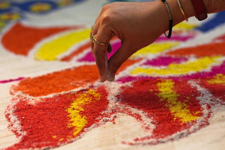 Close-up of hand making mandala
